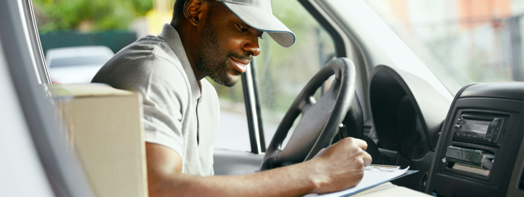 A delivery boy in his geolocation car